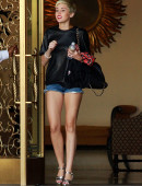 Miley-Cyrus-in-Shorts-and-Stripper-heels-2