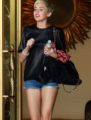 Miley-Cyrus-in-Shorts-and-Stripper-heels-8