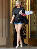Miley-Cyrus-in-Shorts-and-Stripper-heels-9