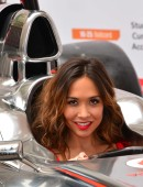 Formula 1 star Jenson Button is joined by TV personality Myleene Klass to pose for pictures with a McClaren car to promote the car manufacturer's sponsor Santander in London