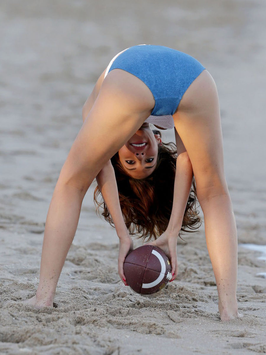 **EXCLUSIVE** Farrah Abraham shows off her curves as she takes a sunset walk and plays with a football on the beach in Miami