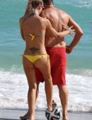 Laura Cremaschi and boyfriend Andrea Perone playing soccer on the beach in Miami