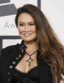 Actress Tia Carrere arrives at the 56th annual Grammy Awards in Los Angeles