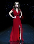 Giada De Laurentiis  presents a creation by Carolina Herrera for the The Heart Truth Fall 2014 collection during New York Fashion Week