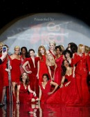 Models pose as they present creations for the The Heart Truth Fall 2014 collection during New York Fashion Week