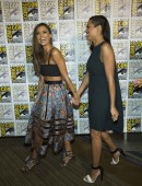 """Cast members Alba and Dawson smile at a press line for """"Sin City: A Dame to Kill For"""" during the 2014 Comic-Con International Convention in San Diego"""