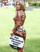 Joanna Krupa wearing Bodypaint while Protesting Outside Westminster, London