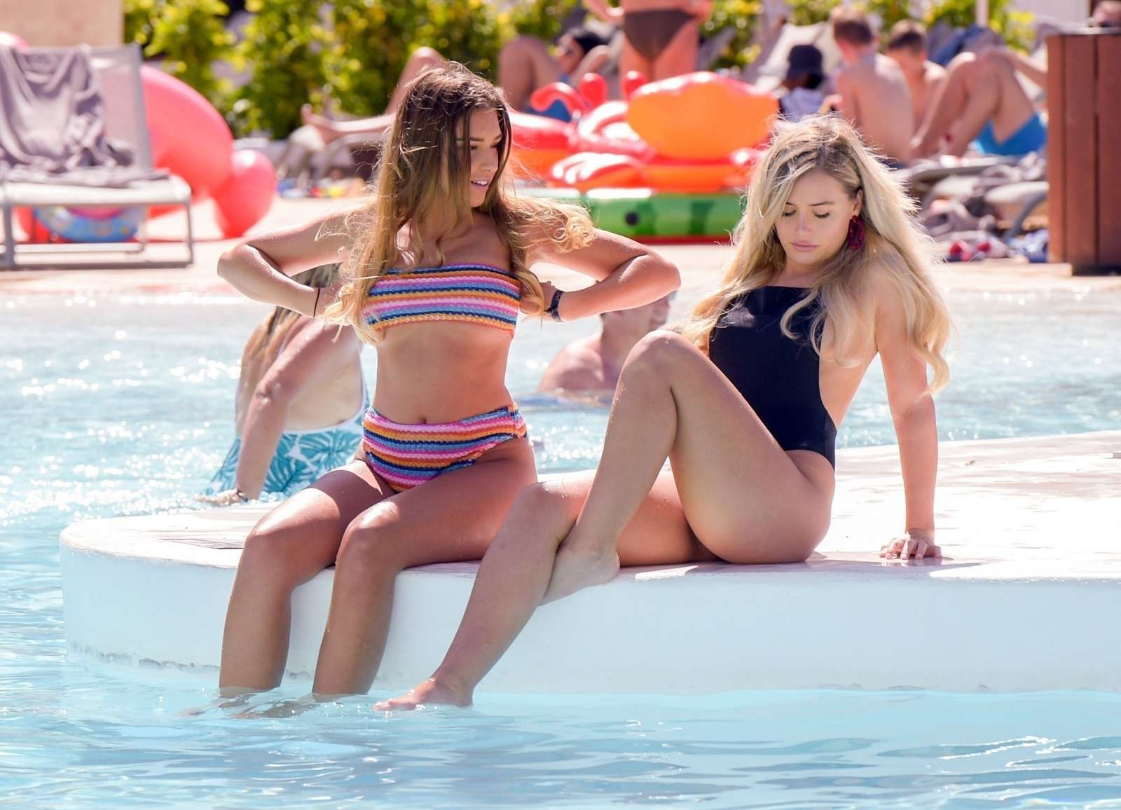 Zara McDermott and Ellie Brown in Bikini and Swimsuit at a Pool in Ibiza