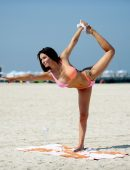 Laura Anderson Practices the art of Yoga at the Beach in Dubai