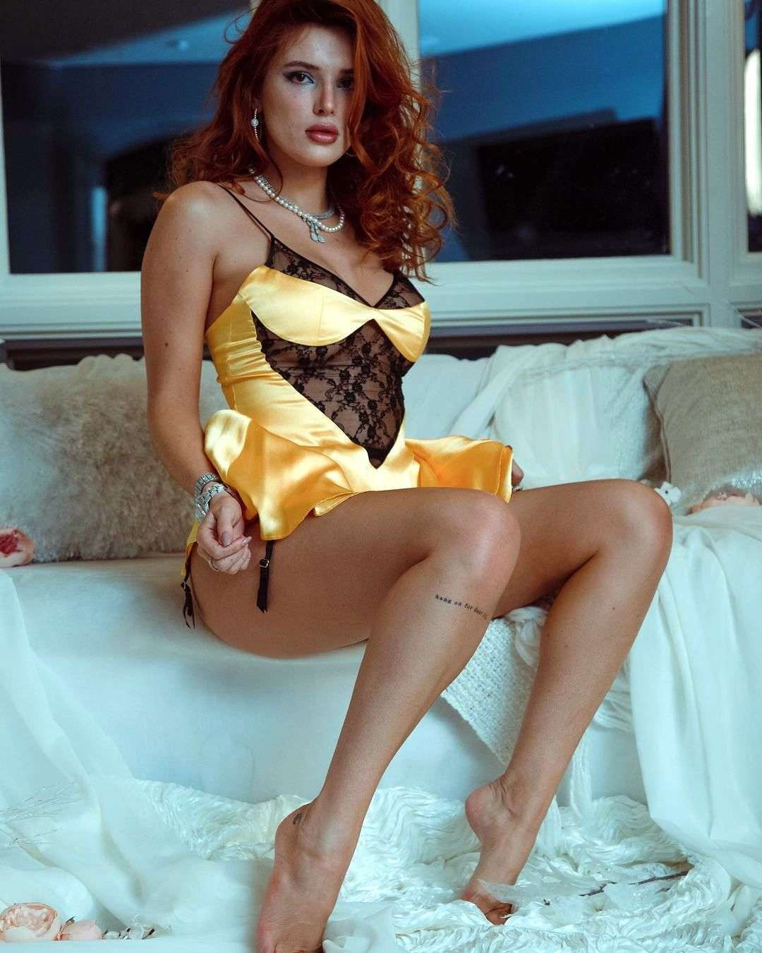 Bella Thorne Leggy and Cleavage in a Sheer Lingerie